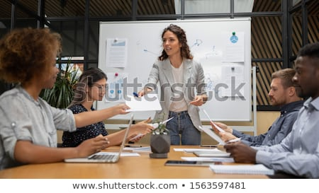 Executivelooking through report Stock photo © photography33