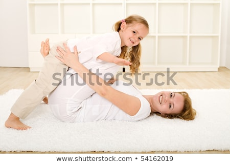 Little child laying on a rug Stock photo © photography33