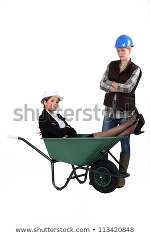 Architect laying in wheelbarrow whilst worker watches Stock photo © photography33