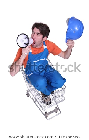 worker seated in cart shouting in loudspeaker Stock photo © photography33