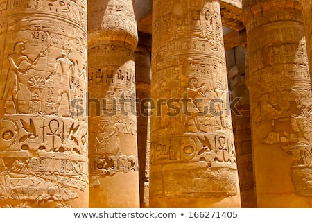 ancient hieroglyphics on stone column stock photo © gbuglok