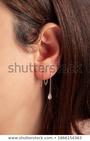 brunette with long hair silver earing Stock photo © carlodapino