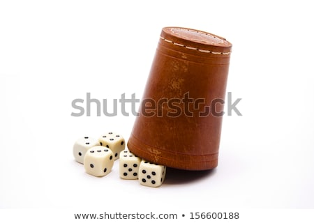 A dice with dice cup Stock photo © Roka