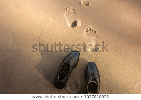 Traces of man's shoe on the sand  Stock photo © vavlt