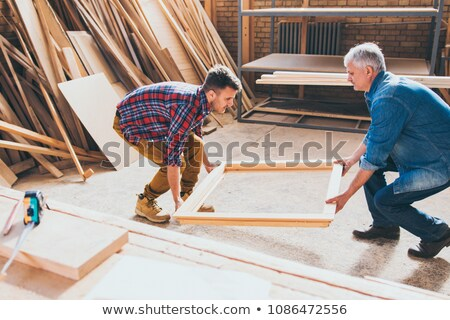 carpenter holding a wooden window frame stock photo © photography33