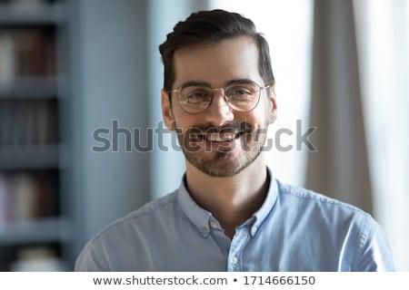 クローズアップ 幸せ 小さな ビジネスマン 見える カメラ ストックフォト © HASLOO