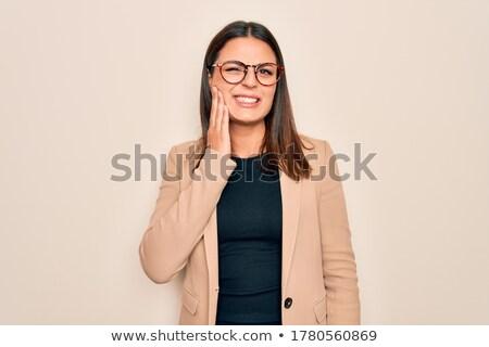 Brunette vrouw kiespijn geïsoleerd witte meisje Stockfoto © dacasdo
