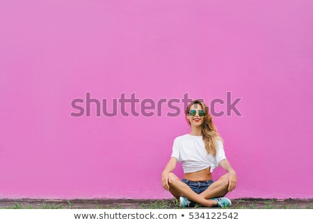 Pretty girl in lotus position Stock photo © Aikon