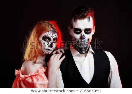 portrait of beautiful gothic girl wearing halloween costume stock photo © elisanth