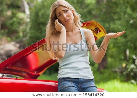Jonge blond vrouw kapotte auto meisje auto Stockfoto © Aikon