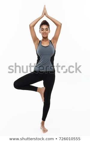 woman doing exercises isolated on the white stock photo © elnur