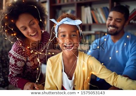 fiatal · félvér · család · karácsony · portré · családi · portré - stock fotó © monkey_business