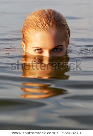 beautiful blonde woman swimming in the sea Stock photo © stryjek