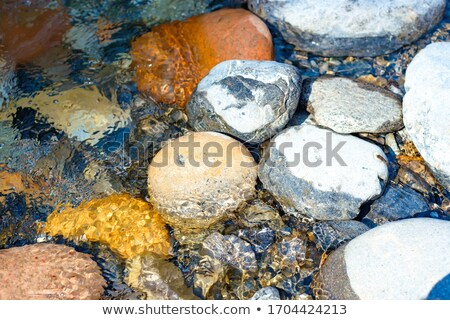 Water's edge with small stones Stock photo © Mps197
