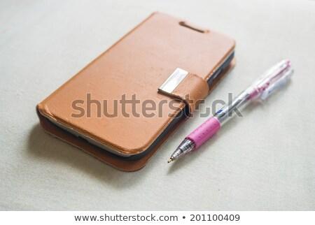 Mobiltelefon bőr izolált fehér Stock fotó © bmonteny
