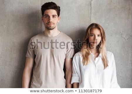 Boldog divat pár áll szemtől szembe átkarol Stock fotó © feedough