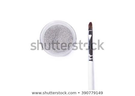Loose Eye Shadows In Transparent Jars And Makeup Brush Photo stock © Elisanth