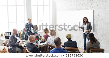 Businesswomen interacting at office Stock photo © HASLOO
