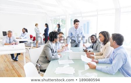 Többnemzetiségű üzleti csapat megbeszélés boldog munka diák Stock fotó © deandrobot