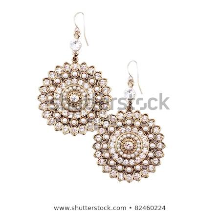 Beautiful golden glass beads closeup on white background Stock photo © Nneirda