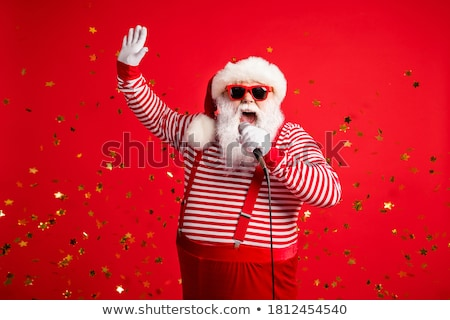 Man's hand in a gray striped shirt holding a microphone Stock photo © GeniusKp