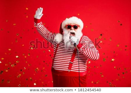 Hand grijs gestreept shirt microfoon Stockfoto © GeniusKp