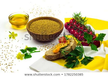 Organikus citromsárga mustár kerámia tál fehér Stock fotó © ziprashantzi