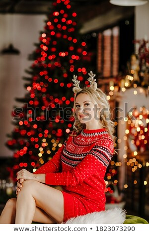 Young beautiful barefooted woman in red dress sits on white leat Stock photo © Paha_L