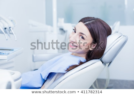 dentist with camera and patient stock photo © bezikus