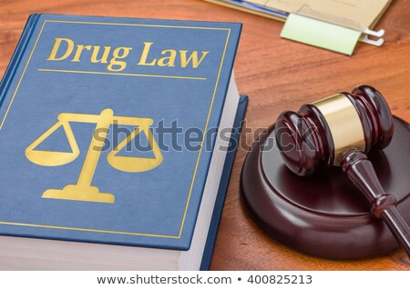a law book with a gavel   drug law stock photo © zerbor