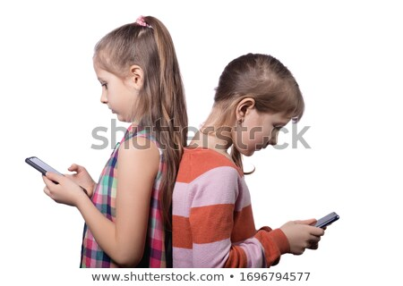 girls ignoring each other on the phone Stock photo © Giulio_Fornasar