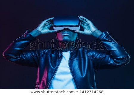 Man with VR goggles watching 360 video Stock photo © stevanovicigor