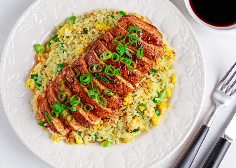Disznóhús vesepecsenye rizs mártás étel vacsora Stock fotó © Digifoodstock
