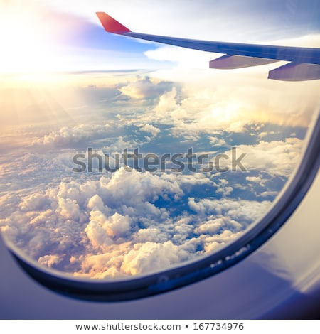 Clouds and sky as seen through window of an aircraft Stock photo © zurijeta