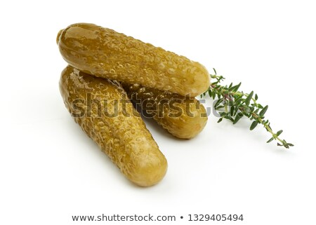 Whole marinated cornichon and few slices Stock photo © digitalr