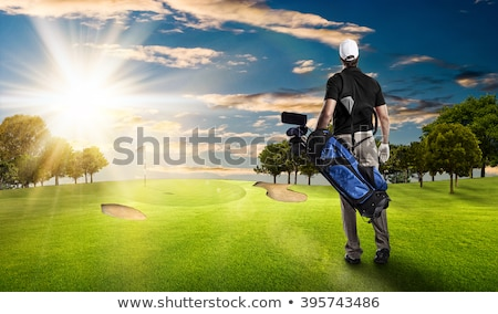 Stock photo: golfclubs in black bag on back of golfer