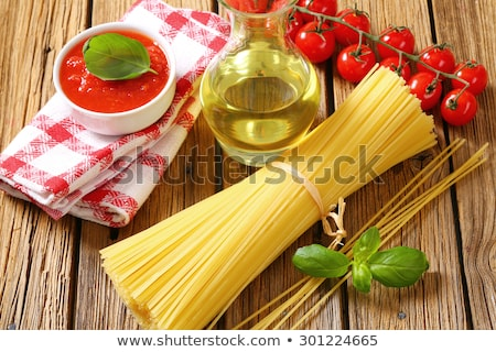 Still life of dried spaghetti, tomato puree and olive oil Stock photo © Digifoodstock