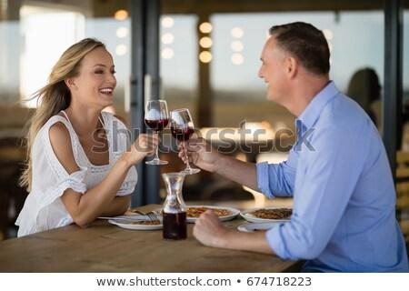 Hartelijk paar wijnglas maaltijd restaurant Stockfoto © wavebreak_media