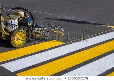 Worker is painting zebra pedestrian crosswalk Stock photo © stevanovicigor