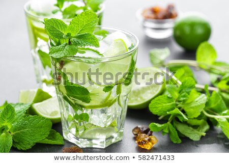 Mojito Cubano or caipirinha cocktail, iced drink with lime and mint Stock photo © yelenayemchuk