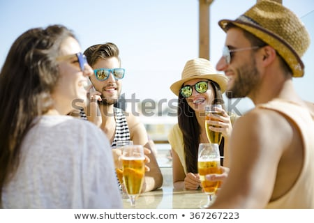 happy young casual couple talking on phones celebrating success Stock photo © feedough