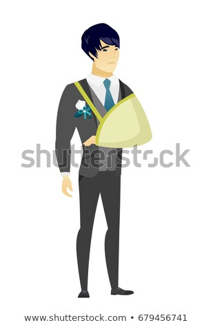 Injured groom with broken arm. Stock photo © RAStudio