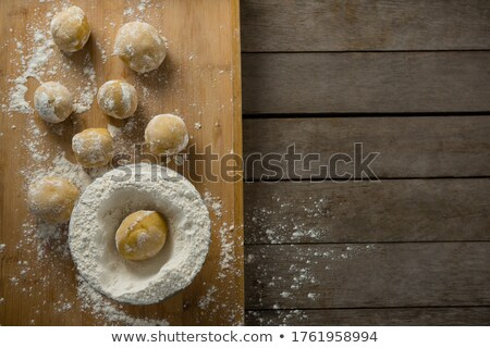 Dough ball placed over flour on a wooden table Stock photo © wavebreak_media