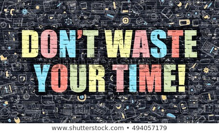 Dont Waste Your Time Concept. Multicolor on Dark Brickwall. Stock photo © tashatuvango