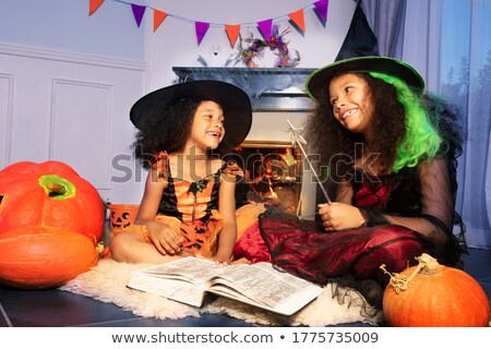 witch reads stories of fear on Halloween Stock photo © adrenalina