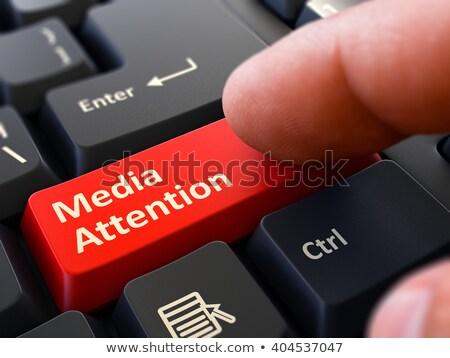 Media Attention - Clicking Red Keyboard Button. Stock photo © tashatuvango