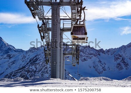 Snowblower and cable car in ski resort Stock photo © IS2