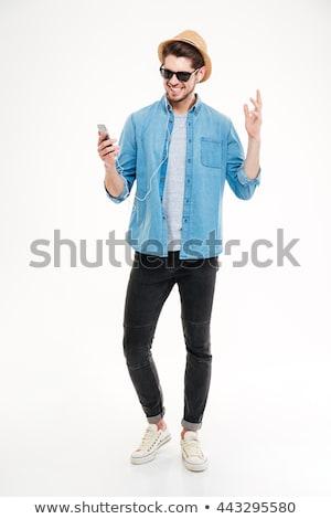 Teljes alakos portré boldog lezser férfi fülhallgató Stock fotó © deandrobot