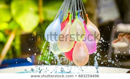 água · pistola · mulher · rosa · isolado - foto stock © is2