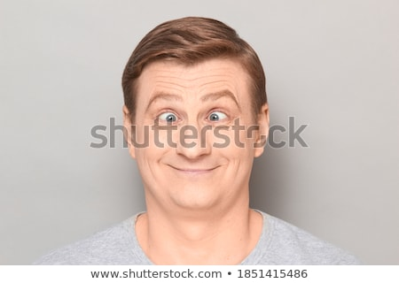 Headshot of funny happy man fooling around and making faces with Stock photo © deandrobot